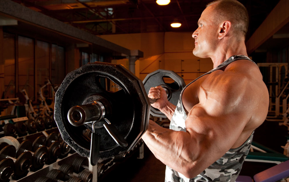 Weight lifter doing biceps curls